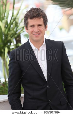 CANNES, FRANCE - MAY 21: Guillaume Canet attends 'L'Homme Qu'On Aimait Trop' photocall at the 67th Annual Cannes Film Festival on May 21, 2014 in Cannes, France.
