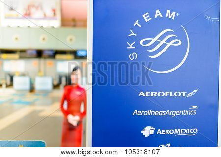 HANOI, VIETNAM - MAY 11, 2015: close-up shot of banner with SkyTeam logo. SkyTeam was the last of the three major airline alliances to be formed, the first two being Star Alliance and Oneworld.