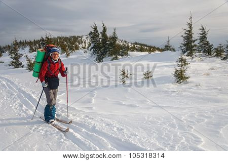 Woman cross country skiing in the mountain
