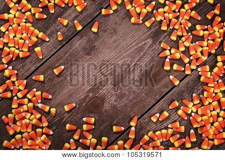 Candy corn on a wooden background