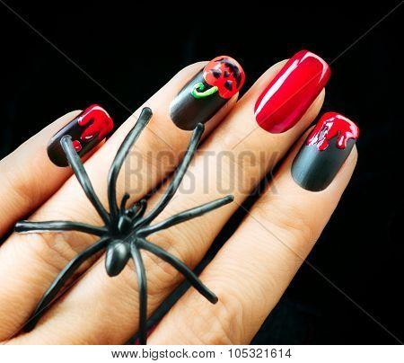 Halloween Nail art design. Nail Polish. Beauty hands. Trendy Stylish Colorful Nails and Nailpolish. Black matte polish with blood drips and pumpkin
