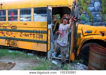 MUSKOGEE, OK - Sept. 12: Bloody zombies hide in school bus during the Castle Zombie Run at the Castle of Muskogee in Muskogee, OK on September 12, 2015.