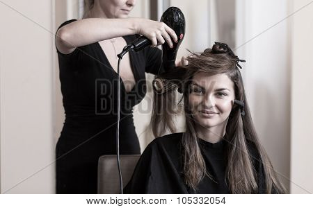 Hairdresser Is Blow-drying