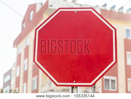 Photograph of a blank red traffic stop sign with all text letters removed