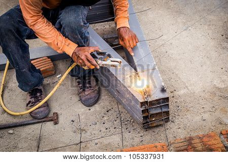 Close hand man arc welding or stick welding iron poster