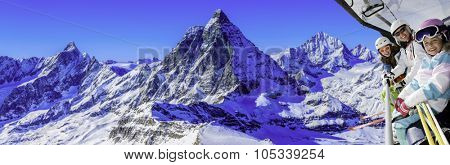 Ski, skiing in Zermatt, Switzerland - skiers on ski lift with view of Matterhorn