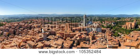 Siena, Italy panorama rooftop city view. Siena Cathedral, Duomo di Siena as seen from Mangia Tower, Italian Torre del Mangia. Tuscany region landscape