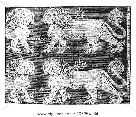Byzantine silk expanded the tenth century, purple background, lions, foliage and yellow markings, vintage engraved illustration. Industrial encyclopedia E.-O. Lami - 1875.