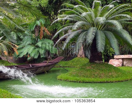 Canoe In The Tropical Garden