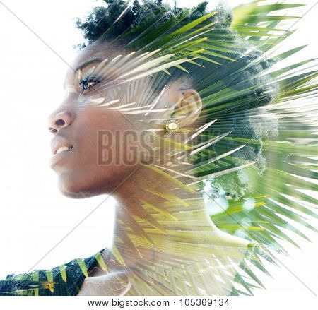 Double exposure portrait of attractive woman combined with photograph of palm tree poster