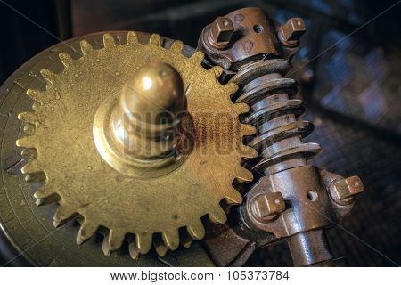 Closeup on mechanical gear wheels and old industrial machine parts.