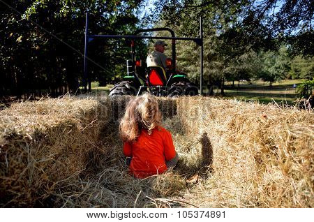 Young girl going on a hay ride