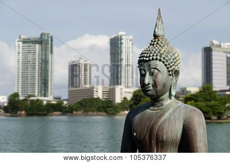 Buddha Statue With Colombo In Background