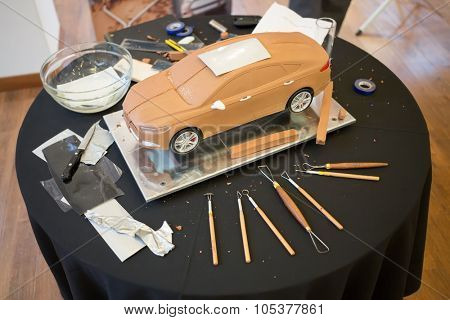 RUSSIA, MOSCOW -?? 4 DEC, 2014: Ford car model made of clay, is on the table, next to lay tools.