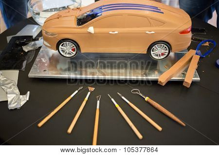 RUSSIA, MOSCOW -?? 4 DEC, 2014: Car model with blue tape and paper at the press event for Ford in SREDA loft.