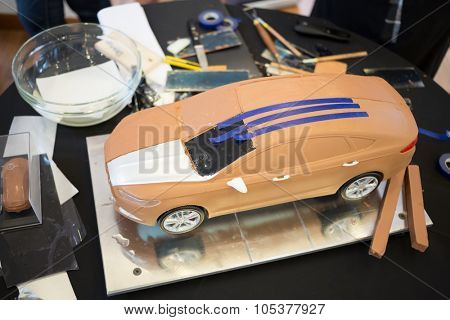 RUSSIA, MOSCOW -?? 4 DEC, 2014: Table with tools for modeling and miniature model car at the press event for Ford in SREDA loft.