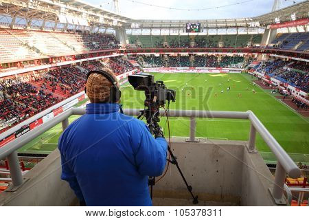 RUSSIA, MOSCOW - NOV 02, 2014: Close-up view of operator shoots video of football match on the field of Locomotive sports arena.