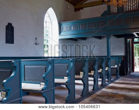 Interior View Of A Traditional Church With Empty Pews
