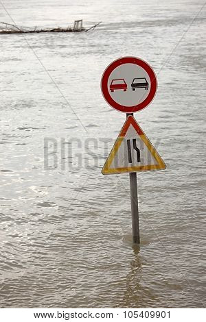 Flooded street n Budapest with traffic sign poster