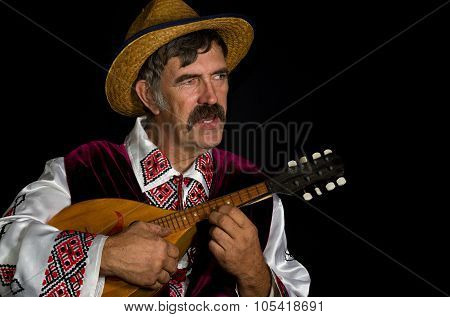 Portraitof Ukrainian farmer playing mandolin and singing
