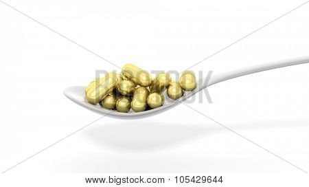 Golden caplets inside a spoon, isolated on white background.
