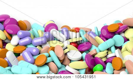 Various colorful pills in a pile with copy-space, isolated on white background.