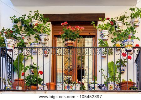 Traditional European Balcony with colorful flowers and flowerpots