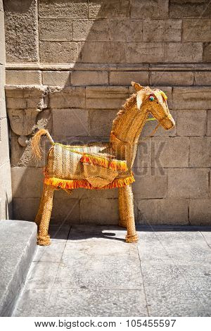 BARCELONA, SPAIN - MAY 02: Quaint rustic statue of a horse displayed in Poble Espanyol, Barcelona, Spain, a section of the city set aside as an architectural museum. May 02, 2015