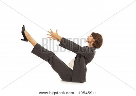Young businesswoman in suit doing yoga