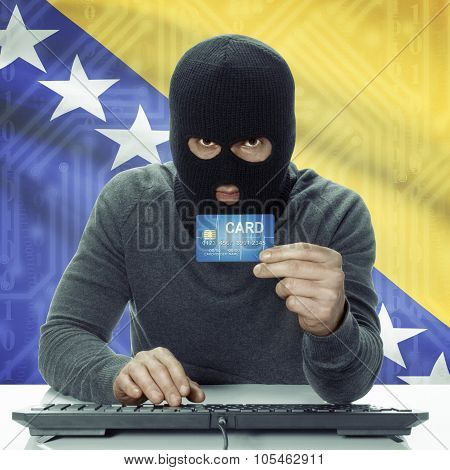 Dark-skinned hacker with credit card in hand and flag on background - Bosnia and Herzegovina poster