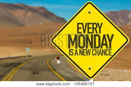 Every Monday Is a New Chance sign on desert road