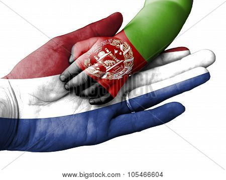 Adult Man Holding A Baby Hand With Netherlands And Afghanistan Flags Overlaid. Isolated On White