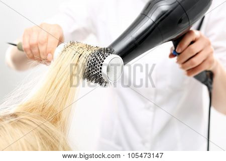 Medium-length hair, hairdresser models hair brush . poster