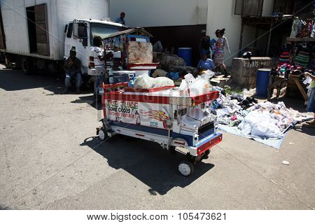 FALMOUTH, JAMAICA SEPTEMBER 27, 2015 : Street Vendor Cart selling Fruit juices and drinks to thirsty residents and tourist from around the world. Falmouth Jamaica on September 27, 2015.