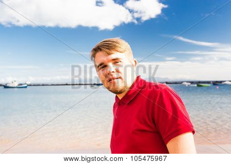 Smiling man at the beach