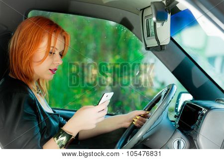 Woman Using Mobile Phone In The Car.