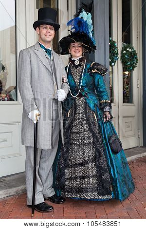 Galveston, Tx/usa - 12 06 2014: Smiling Couple Dressed In Victorian Style At Dickens On The Strand F