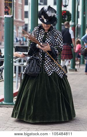 Galveston, Tx/usa - 12 06 2014: Lady Dressed In Victorian Style Texting On The Phone At Dickens On T