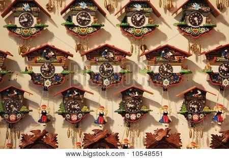 A wall full of traditional Austrian cuckoo clocks poster