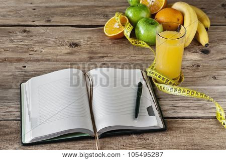 Diary With Fruit And A Glass Of Fresh Juice