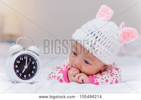 Cute Baby Girl And Alarm Clock Wake Up In The Morning