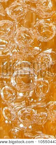 Airbubbles in golden water