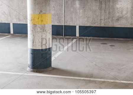 Empty Underground Parking Interior, Round Column