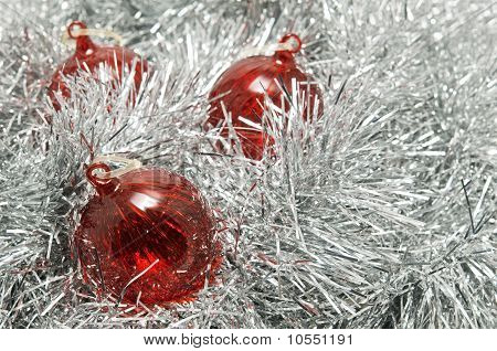 Red Glass Baubles On Silver Tinsel.