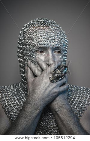 Knight, man in chain mail and leather painted silver, medieval warrior