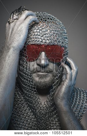 Soldier, man in chain mail and leather painted silver, medieval warrior