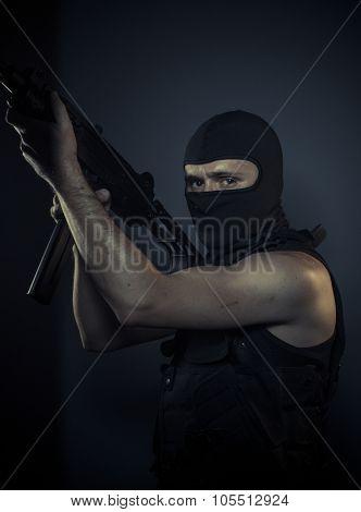 Outlaw, terrorist carrying a machine gun and balaclava
