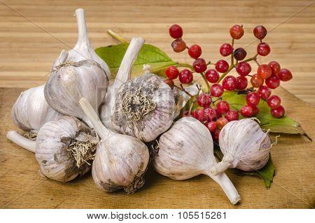 Garlic And Viburnum On An Old Cutting Board