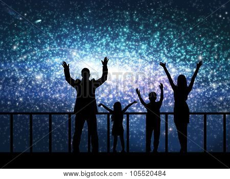 Silhouette of happy family in cosmos