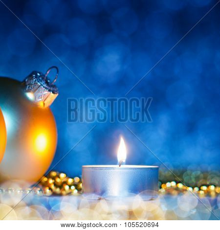 Christmas decoration with christmas balls and candlelight